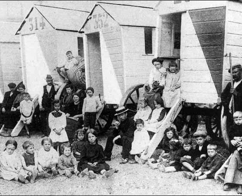 Belgian refugees, temporarily housed in beach cabins in Ostend during World War One, before moving to England or France.